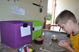 electronics workspace, boy, tools