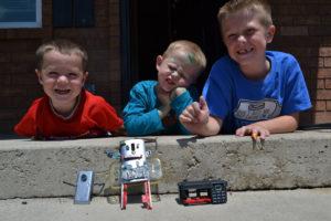 boys, smiling, electronics, action figures