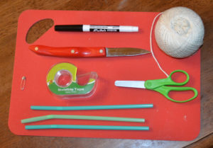 scissors, knife, straws, cutting board, dry erase marker, string, tape
