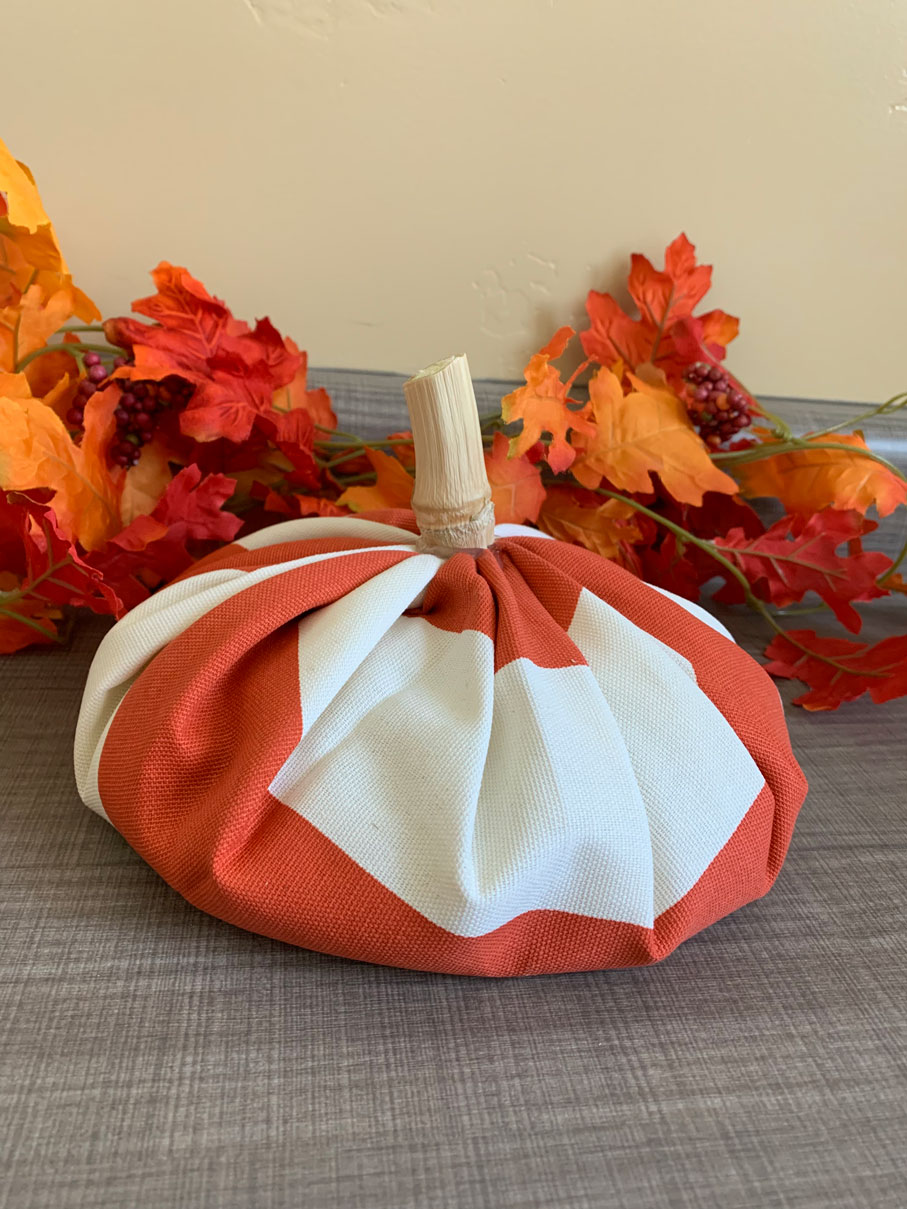 This fabric pumpkin decoration is incredibly easy to make and looks great added to your home decor or as a center piece for your next Halloween Party! Perfect Halloween or Fall decoration and centerpiece.