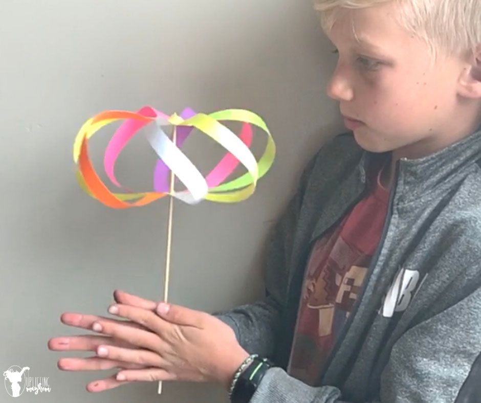 This mesmerizing paper spinner toy is a perfect activity for your kids that will leave them says WOW!! It is simple and easy to make with little help!