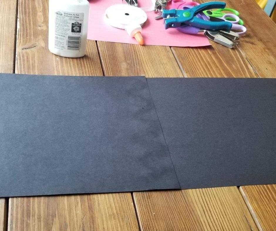 Black construction paper glued together length wise
